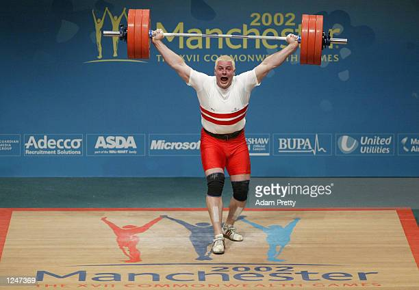 Giles Greenwood of England on his way to Gold in the Snatch category in Weightlifting at the Manchester International Convention Centre during the...