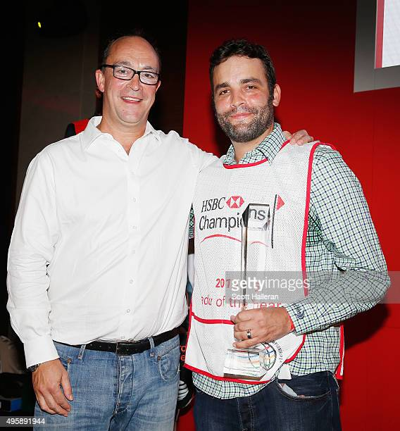Giles Morgan Global Head of Sponsorship and Events for HSBC poses with Michael Greller on stage after Greller was named 2015 Caddy of the Year at the...