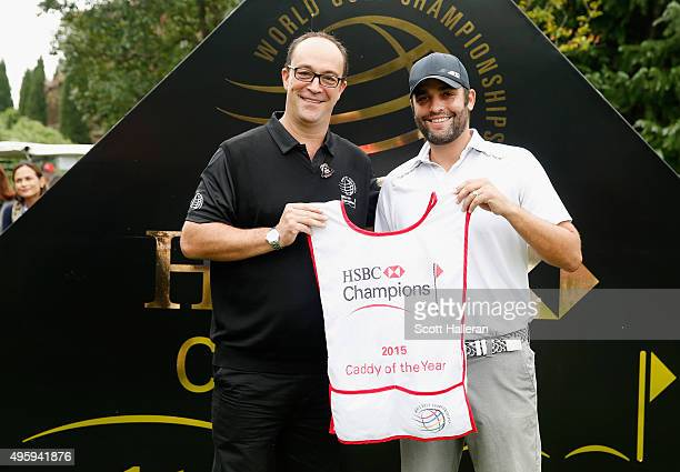 Giles Morgan Global Head of Sponsorship and Events for HSBC poses with Michael Greller on the first tee after Greller was named 2015 Caddy of the...