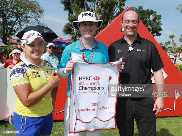 Giles Morgan Head of Sponsorship Events at HSBC with 2017 Caddy of the Year Peter Godfrey and his player Ha Na Jang of South Korea on the first hole...