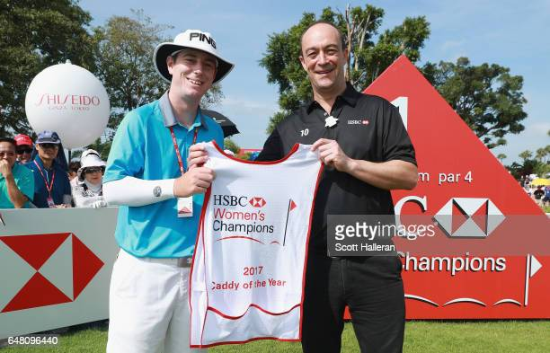 Giles Morgan Head of Sponsorship Events at HSBC with 2017 Caddy of the Year Peter Godfrey on the first hole during the final round of the HSBC...
