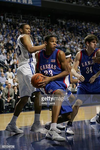 J Giles of the Kansas Jayhawks drives against Randolph Morris of the Kentucky Wildcats on January 9 2005 at Rupp Arena in Lexington Kentucky Kansas...