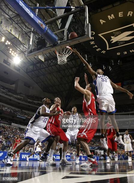 J Giles of the Kansas Jayhawks lays up a shot against the Nebraska Cornhuskers during the semifinals round of the Phillips 66 Big 12 Men's Basketball...