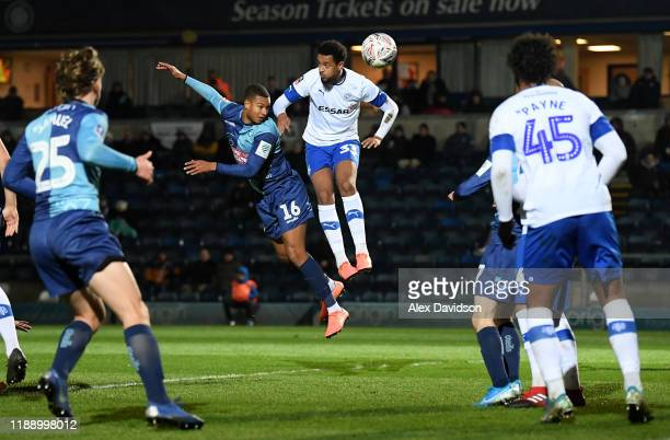 Giles Phillips of Wycombe Wanderers attempts to shoot as Cameron Borthwick-Jackson of Tranmere Rovers blocks during the FA Cup First Round Replay...