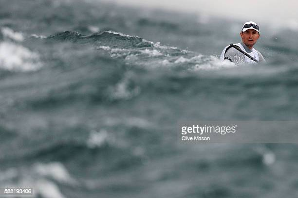 Giles Scott of Great Britain competes in the Men's Finn class on Day 5 of the Rio 2016 Olympic Games at the Marina da Gloria on August 10 2016 in Rio...