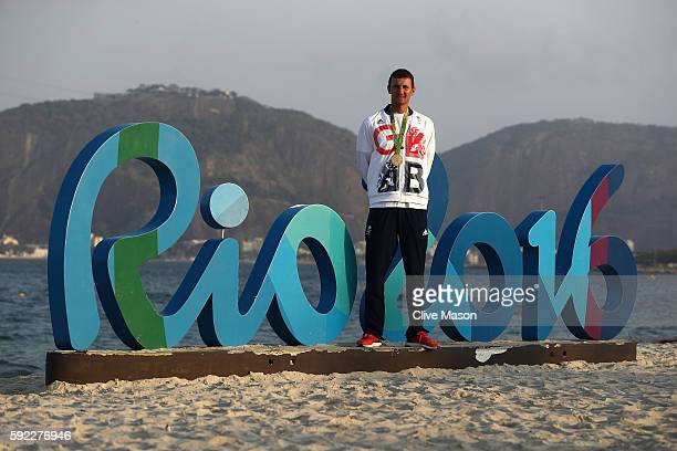 Giles Scott of Great Britain poses with his gold medal after winning the Finn class medal race at the Marina da Gloria on Day 14 of the 2016 Rio...
