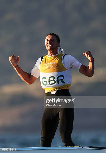 Giles Scott of Great Britain reacts after sealing the gold medal in the Finn class ra on Day 9 of the Rio 2016 Olympic Games at the Marina da Gloria...
