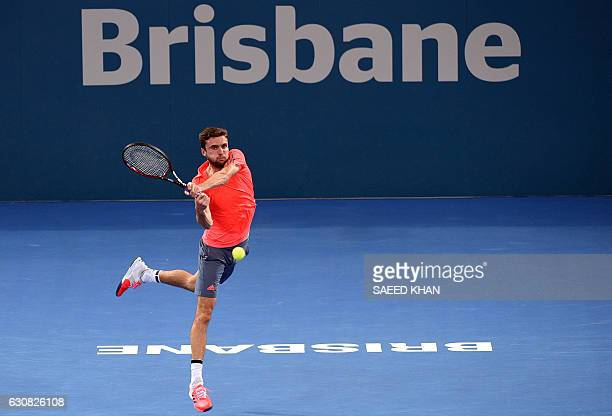 TOPSHOT Giles Simon of France hits a return against compatriot Lucas Pouille during their men's singles first round match at the Brisbane...