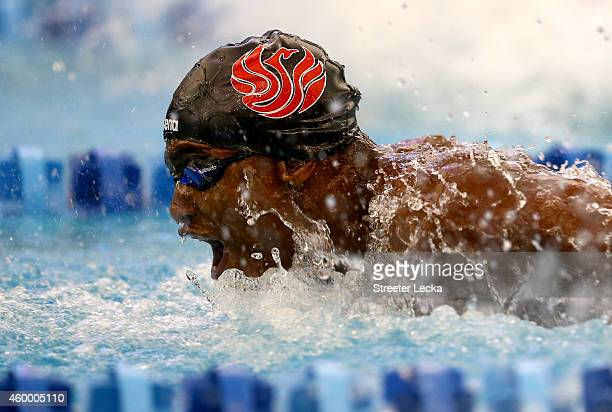 Giles Smith competes in the men's 100 yard butterfly finals during the USA Swimming 2014 ATT Winter National Championships at the Greensboro Aquatic...
