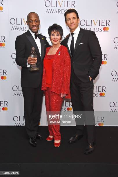 Giles Terera winner of the Best Actor in a Musical award for 'Hamilton' Chita Rivera and Andy Karl pose in the press room during The Olivier Awards...