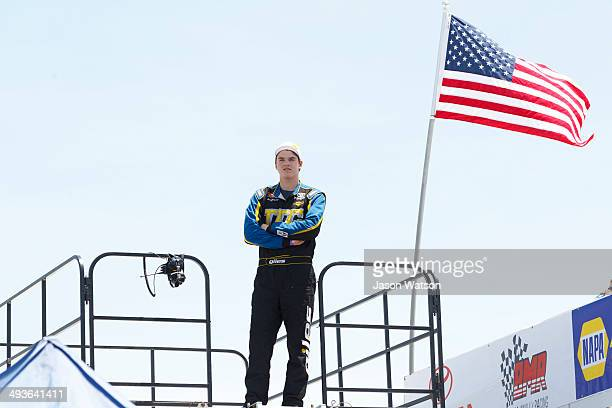 Giles Thornton driver of the TTC Racing/Montana Raceway Park Toyota watches from a top his trailer during practice before the NASCAR KN Pro Series...
