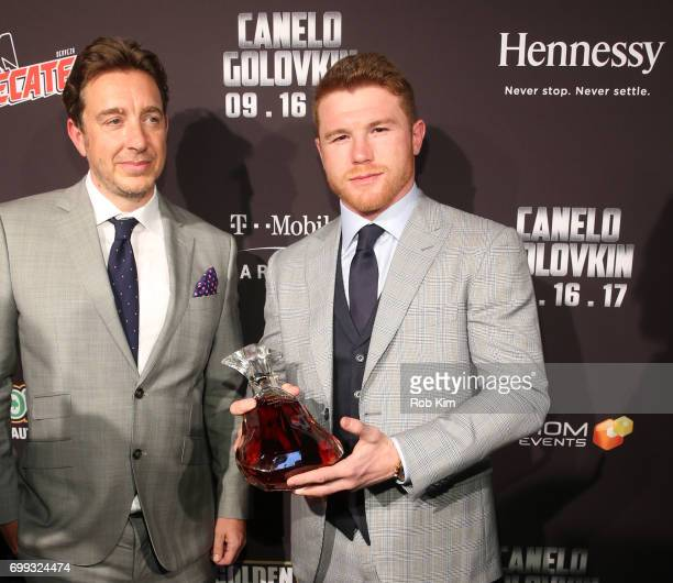 Giles Woodyer Senior Vice President Hennessy presents Lineal and RING Magazine Middleweight World Champion Canelo Alvarez with a custom engraved...