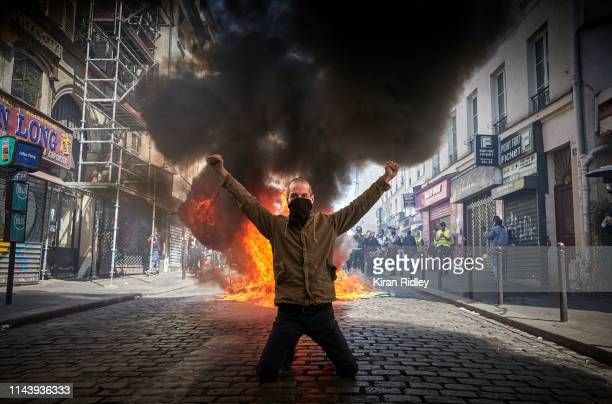 Gilet Jaune in front of a burning barricade during Act 23 of Gilets Jaunes or 'Yellow Vest' protests just five days after the fire of NotreDame...