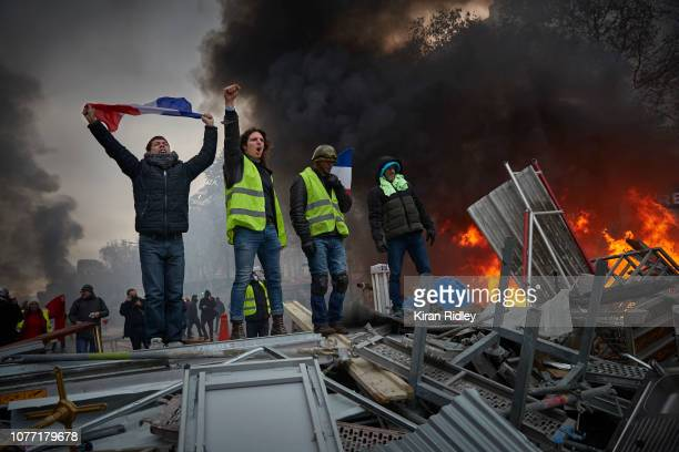Gilets Jaunes, or yellow vests, protesters during violent demonstrations on the Champs Elysees on November 24, 2018 in Paris, France. This is the...