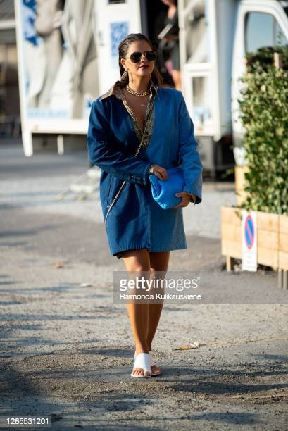 Gili Biegun outside Soeren Le Schmidt wearing long denim half dark half light blue shirt blue bag and little black cross shoulder Jacquemus bag...