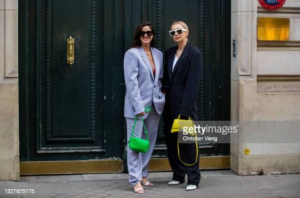 Gili Biegun wearing suit and green bag Justyna Czerniak is seen wearing navy stripped suit, yellow Balmain bag outside Balenciaga on July 07, 2021 in...