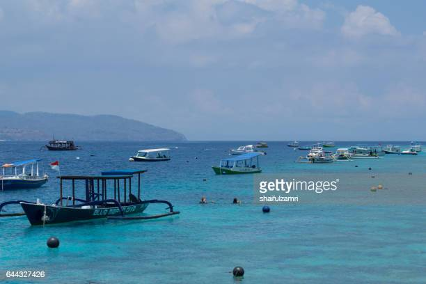gili trawangan is a paradise of global repute, ranking alongside bali and borobudur as one of indonesia's top destinations for tourism. - shaifulzamri stock pictures, royalty-free photos & images