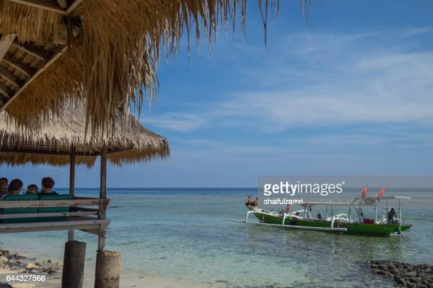 gili trawangan is a paradise of global repute, ranking alongside bali and borobudur as one of indonesia's top destinations for tourism. - shaifulzamri stock-fotos und bilder