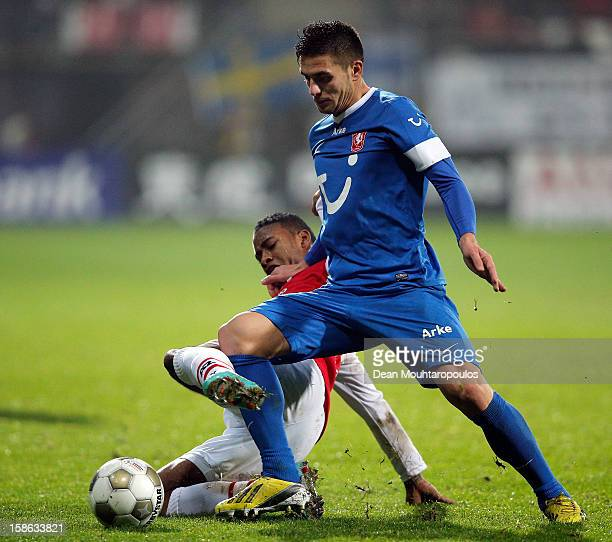 Giliano Wijnaldum of AZ and Dusan Tadic of Twente battle for the ball during the Eredivisie match between AZ Alkmaar and FC Twente at the AFAS...