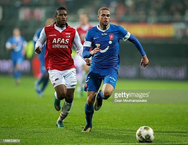 Giliano Wijnaldum of AZ and Luc Castaignos of Twente run for the ball during the Eredivisie match between AZ Alkmaar and FC Twente at the AFAS...