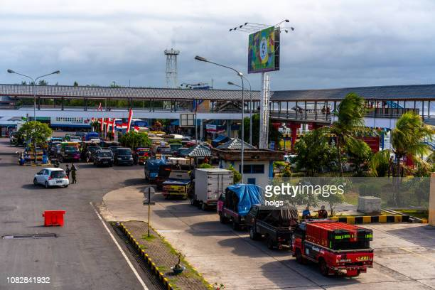 gilimanuk port with passenger transport vehicles, bali, indonesia - harbour stock pictures, royalty-free photos & images