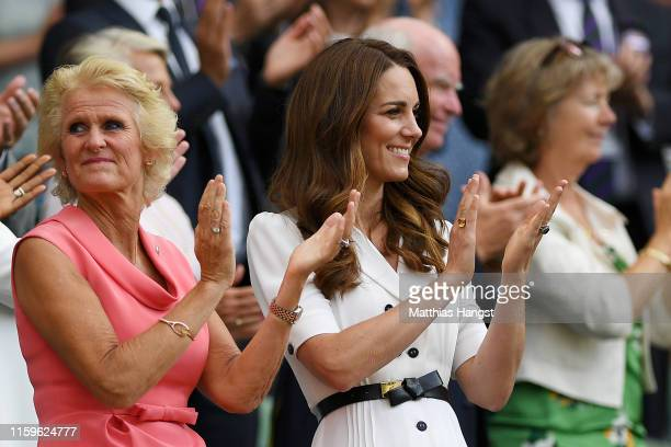 Gill Brook and Catherine Duchess of Cambridge show their support from the royal box during Day two of The Championships Wimbledon 2019 at All England...