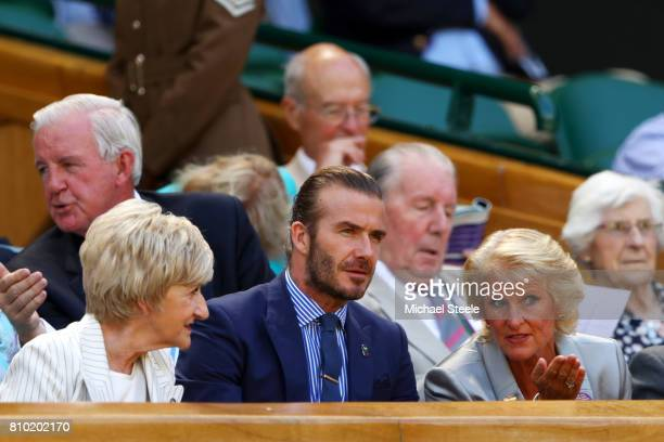 Gill Brook in discussion with David Beckham and Sandra Beckham in the centre court royal box on day five of the Wimbledon Lawn Tennis Championships...