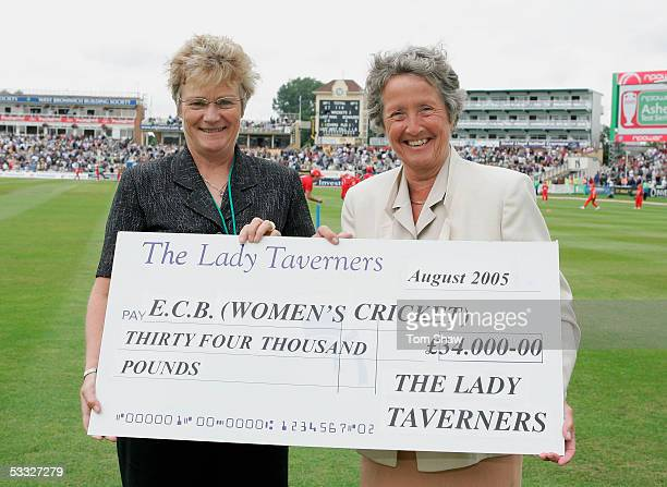 Gill McConway of the ECB receives a cheque from Rachel Heyhoe Flint of the Lady Taverners during day two of the Second npower Ashes Test match...