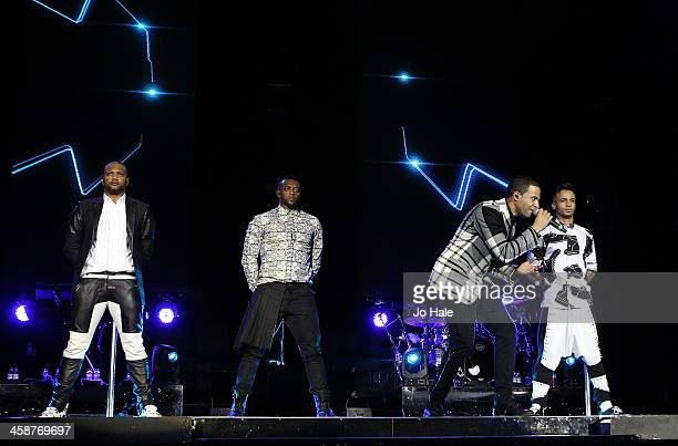 Gill Ortise Williams Marvin Humes and Aston Merrygold of JLS perform on stage at O2 Arena on December 21 2013 in London United Kingdom
