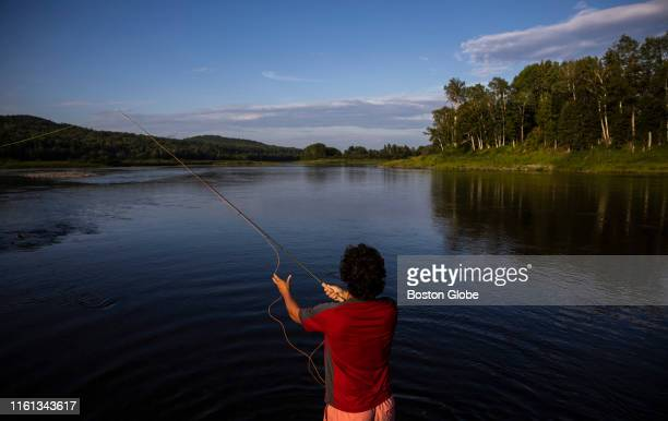 Gill Walker casts his line into the Allagash River after arriving on the shores of Evelyn's Field in the small community of Allagash ME on Aug 1 2019...