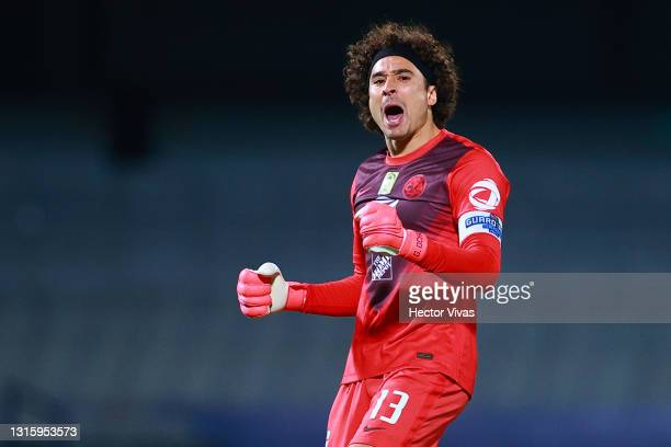 Gillermo Ochoa of America celebrates after the first goal of his team during the 17th round match between Pumas UNAM and America as part of the...