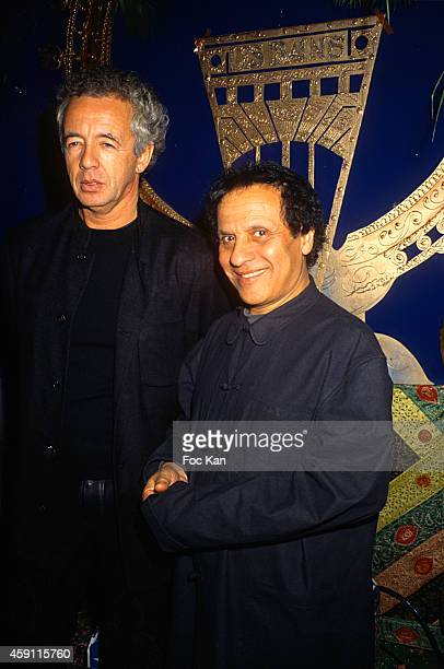 Gilles Bensimon and Azzedine Alaia attend a fashion week Party at Les Bains Douches in the 1990s in Paris France