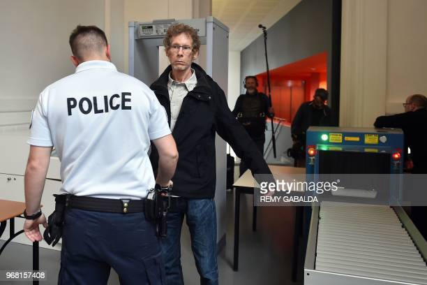 Gilles Bertin, who took part in the robbery of a Brink's storage in April 1988 in Toulouse, is controlled by a policeman upon his arrival at the...