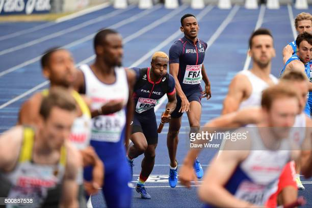 Gilles Biron hands the baton over to Thomas Jordier during the European Athletics Team Championships Super League at Grand Stade Lille Metropole on...
