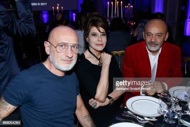 Gilles Blanchard of 'Pierre et Gilles' Fanny Ardant and Christian Louboutin attend the Annual Charity Dinner hosted by the AEM Association Children...