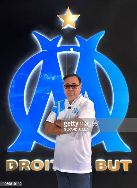 Gilles Castagno poses next to the logo of the Olympic of Marseille at the Velodrome stadium in Marseille on November 22 2018 southern France...