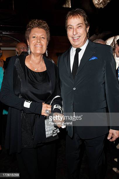 Gilles Dufour and Carla Fendi attend the delivery of the medal of the 'Chevalier de l'Ordre des Arts et des Lettres' to Gilles Dufour at Maxim's on...
