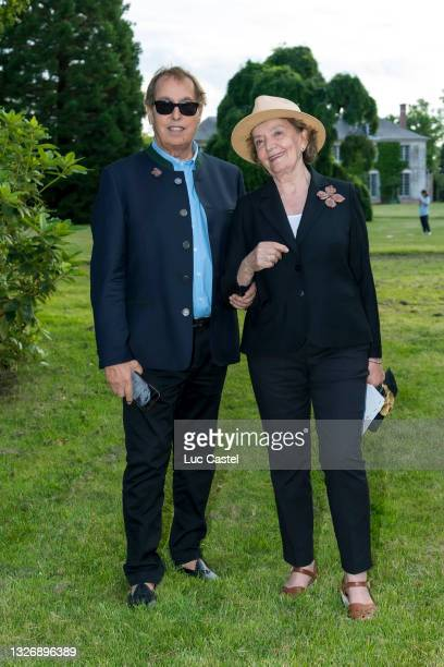 """Gilles Dufour and Caroline Hamisky attend the Exhibition """" Les Lalanne à Trianon """" on July 3, 2021 in Versailles, France."""