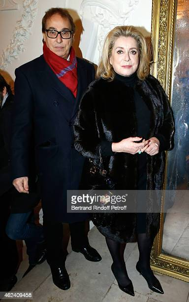 Gilles Dufour and Catherine Deneuve attend the Jean Paul Gaultier show as part of Paris Fashion Week Haute Couture Spring/Summer 2015 on January 28...