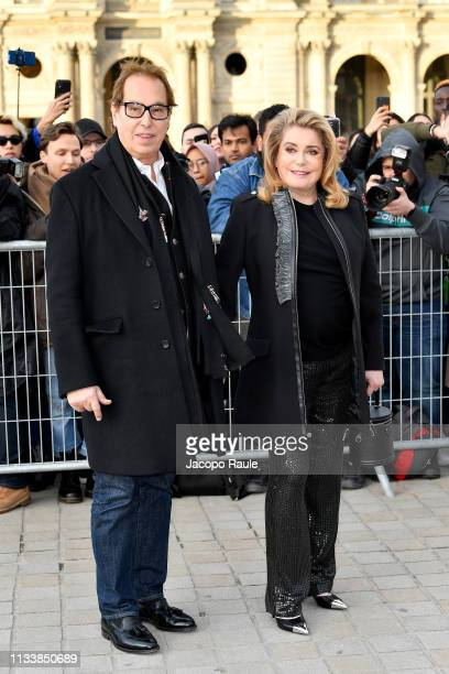 Gilles Dufour and Catherine Deneuve attend the Louis Vuitton show as part of the Paris Fashion Week Womenswear Fall/Winter 2019/2020 on March 05,...