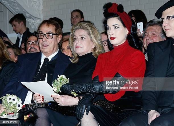 Gilles Dufour Catherine Deneuve and Dita von Teese attend the Jean Paul Gaultier show as part of Paris Fashion Week Haute Couture Spring/Summer 2015...