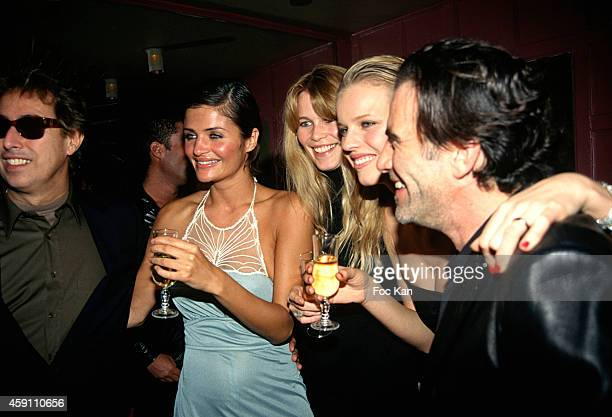 Gilles Dufour Helena Helena Christensen Claudia Schiffer Eva Herzigova and Tico Torres attend a fashion week Party at Les Bains Douches in the 1990s...