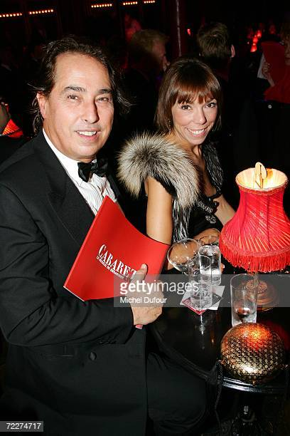 Gilles Dufour with Mathilde Agostinelli attend the musical Cabaret opening night at The Folies Bergere on October 26 2006 in Paris France