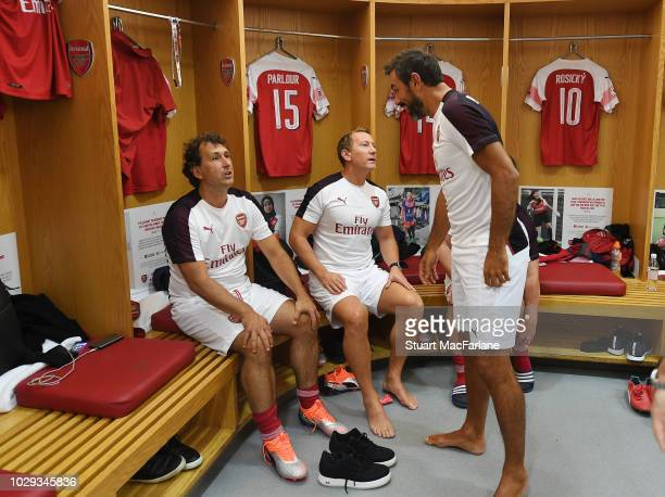 Gilles Grimandi, Ray Parlour and Robert Pires of Arsenal talk in the home changing room before the match between Arsenal Legends and Real Madrid...