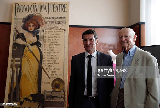 Gilles Jacob and David Lisnard pose for photographers at the Gilles Jacob Auction during the 69th annual Cannes Film Festival at the Martinez Hotel...