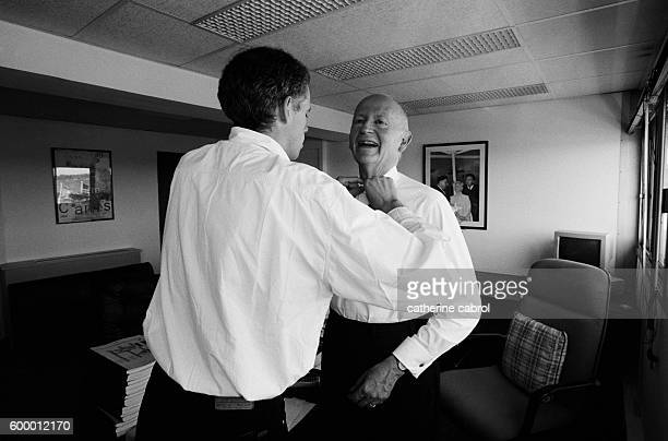Gilles Jacob gets dressed before meeting Cannes Film Festival arrivals, assisted by his son.