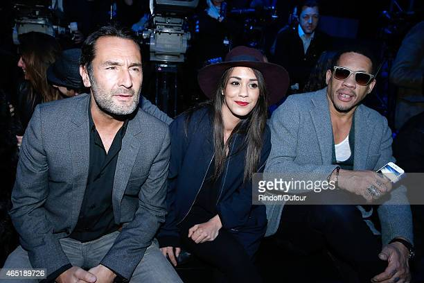 Gilles Lellouche Alice Belaidi and JoeyStarr attend the ETAM show as part of the Paris Fashion Week Womenswear Fall/Winter 2015/2016 Held at Piscine...