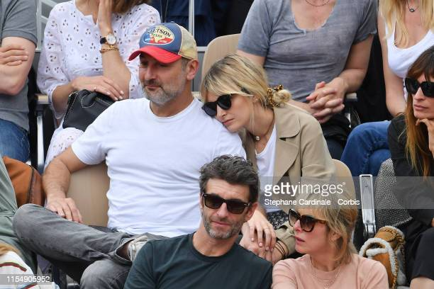 Gilles Lellouche and Alizee Guinochet attend the 2019 French Tennis Open Day Fifteenth at Roland Garros on June 09 2019 in Paris France
