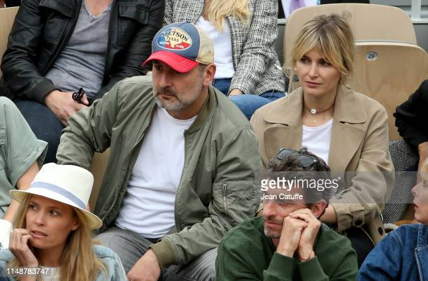 Gilles Lellouche and girlfriend Alizee Guinochet attend the men's final during day 15 of the 2019 French Open at Roland Garros stadium on June 9 2019...