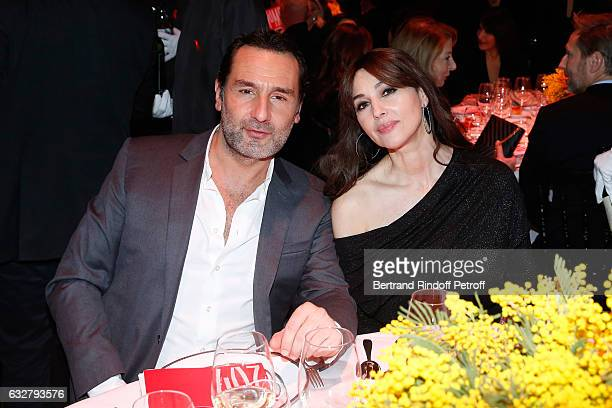 Gilles Lellouche and Monica Bellucci attend the Sidaction Gala Dinner 2017 Haute Couture Spring Summer 2017 show as part of Paris Fashion Week on...